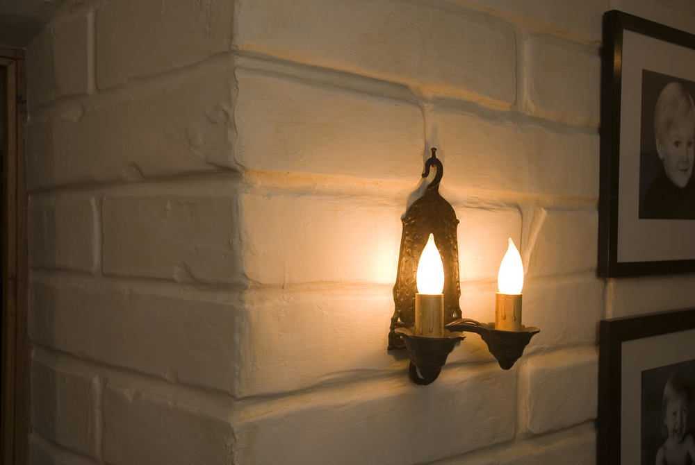 Faux adobe with sconce